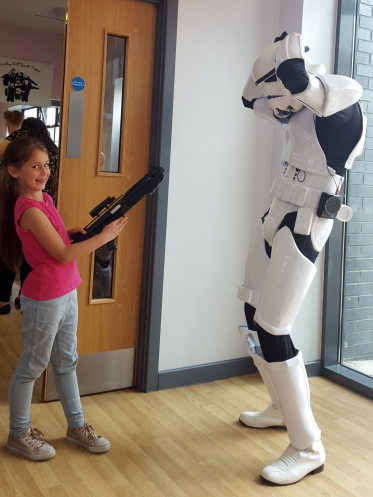Sophie shooting Stormtrooper